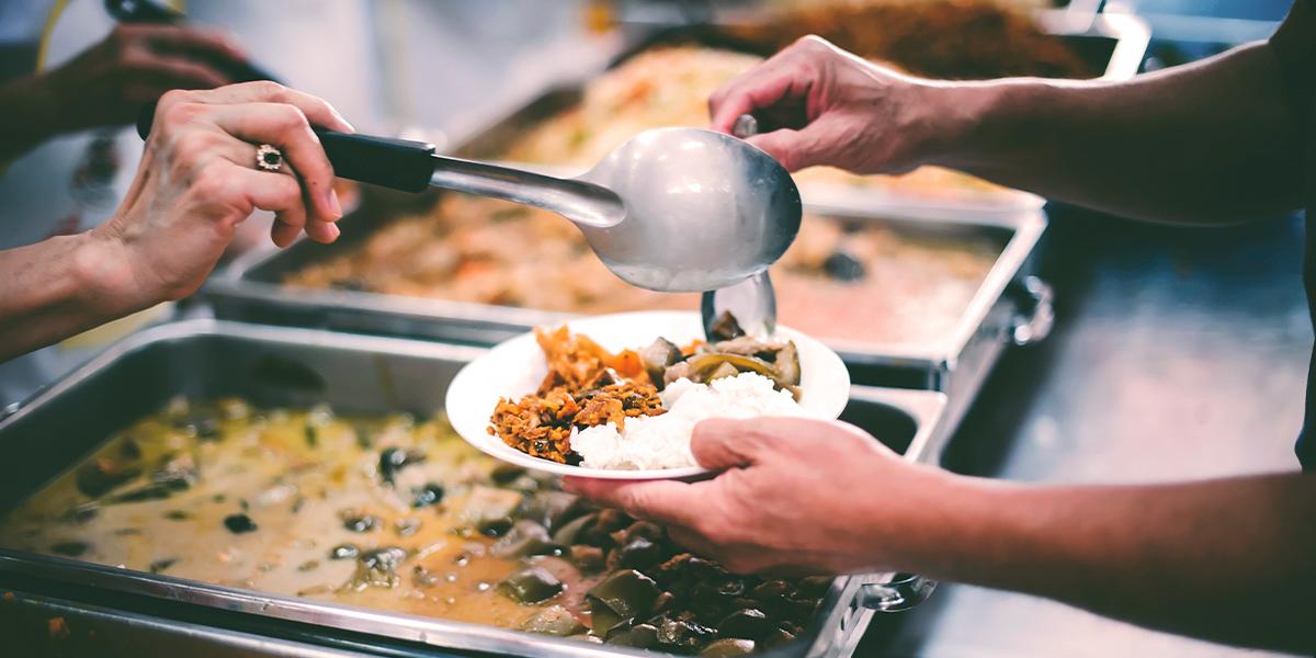 Helping serve food - CDA blog